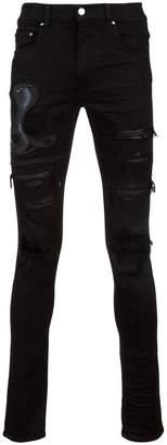 Amiri ripped snake jeans