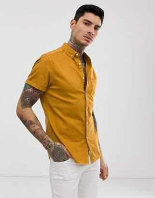 Asos Design DESIGN stretch slim denim shirt in mustard