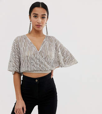 Asos DESIGN Petite embellished wrap top with angel sleeve