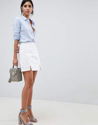 Asos DESIGN denim mini skirt in white with split detail