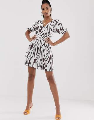Asos Design DESIGN belted mini tea dress with puff sleeve in contemporary print