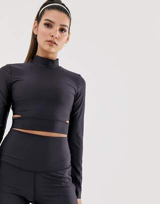 98c24d81 Nike Training cropped long sleeve t-shirt with side cut outs in black