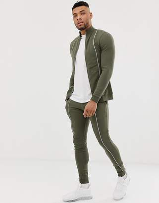Asos Design DESIGN tracksuit muscle track jacket/super skinny joggers with piping in green