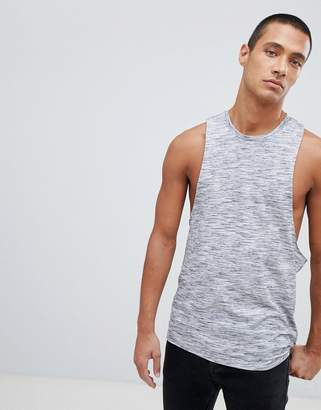 Asos DESIGN sleeveless t-shirt with dropped armhole and racer back in interest fabric