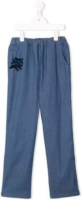 Familiar bow-detail trousers