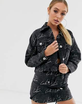 Couture The Club cropped motif denim jacket in washed black
