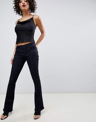 Asos Design Super Low Rise Flared Jeans In Indigo