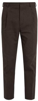 Bottega Veneta Pinstriped cotton and wool-blend trousers