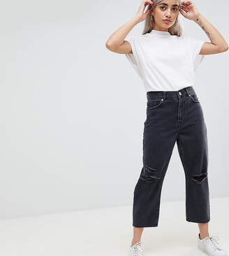 Asos DESIGN Petite barrel leg boyfriend jeans in washed black with knee rips
