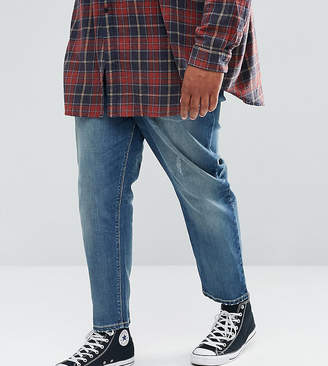 Asos PLUS Tapered Jeans In Mid Wash Blue