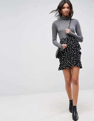 Asos Design DESIGN mini wrap skirt in polka dot print
