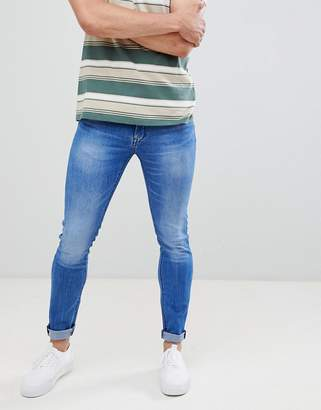 Celio Skinny Fit Jeans In Mid Blue With Raw Hem Edges