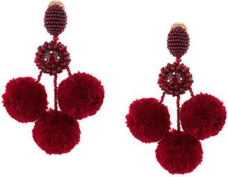 triple pompom earrings