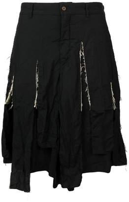 Comme des Garcons shredded shorts