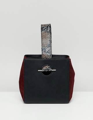 Asos DESIGN leather mix boxy grab clutch bag with snake detail