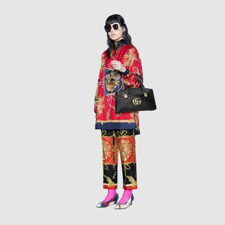 0aa2e9a4 Gucci Oversize shirt with flowers and tassels