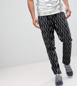 Asos DESIGN Tall festival tapered pants in black geo-tribal print