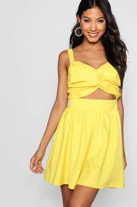 boohoo Leigh Large Twist Knot Front Skater Dress