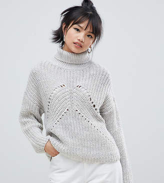 Asos DESIGN Petite roll neck sweater in moving rib stitch