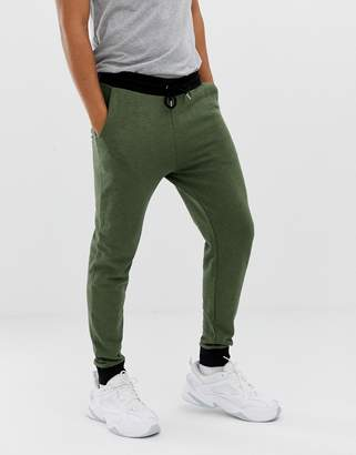 Asos DESIGN skinny sweatpants in khaki interest fabric with contrast waistband and cuffs