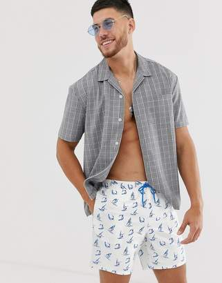 Asos Design DESIGN swim shorts with surfing print in mid length