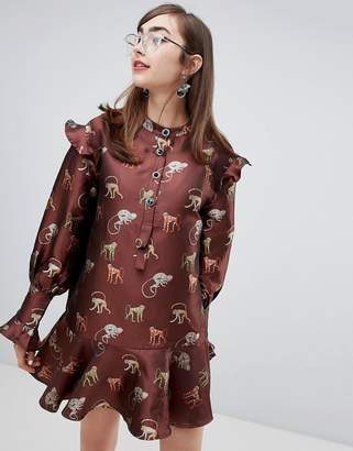 Sister Jane dress with peplum hem and jewel buttons in jungle jacquard embroidery