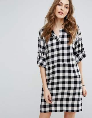 Warehouse Gingham Popper Dress $75 thestylecure.com