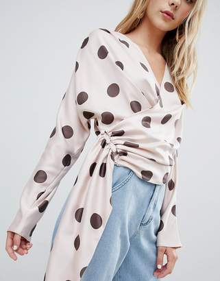 Asos Design DESIGN satin drape long sleeve top with side button detail in spot