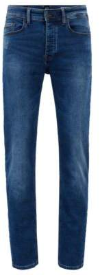 BOSS Hugo Tapered-fit mid-blue jeans in distressed knitted denim 33/34 Blue
