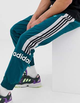 7a9f0eaf2 adidas woven joggers with 3 stripes in green