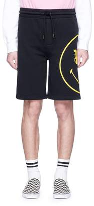 Palm Angels X Smiley® print sweat shorts