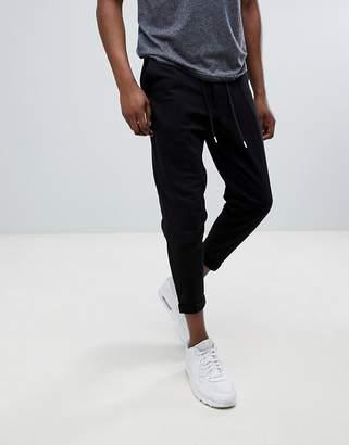 Asos DESIGN slim crop joggers in black with turn up hem