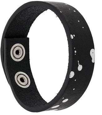 Diesel bracelet with paint spots