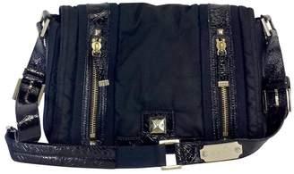 L.A.M.B. Navy Nylon & Black Patent Leather Shoulder Bag $88.99 thestylecure.com
