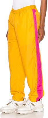 Comme des Garcons Mesh Pants in Yellow & Pink | FWRD