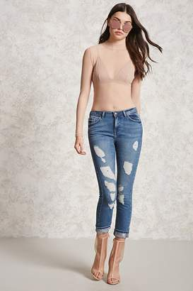 Forever 21 Distressed Mid-Rise Skinny Jeans