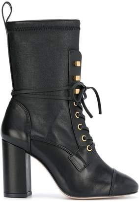 e5596a6cab6 Global Free Shipping at Farfetch · Stuart Weitzman high heel combat boots