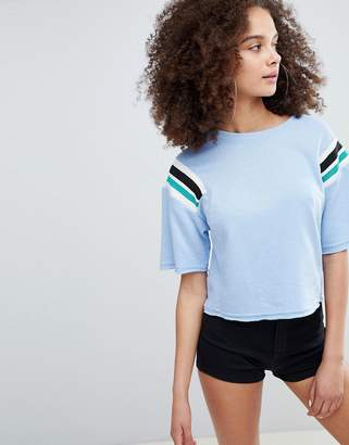 Bershka cropped sweat top with stripe shoulder in blue
