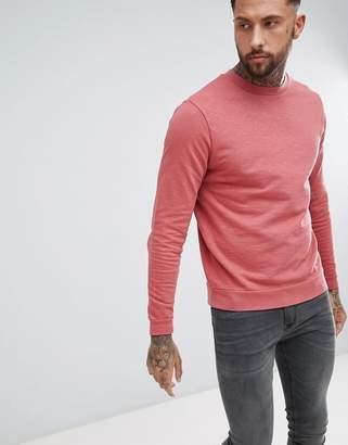 Asos DESIGN sweatshirt in red overdyed marl