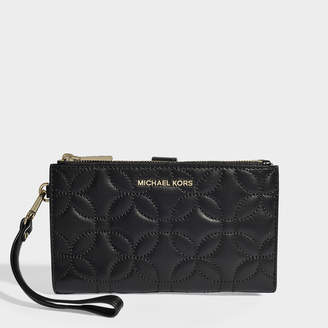MICHAEL Michael Kors Double Zip Wristlet In Black Quilted Lambskin
