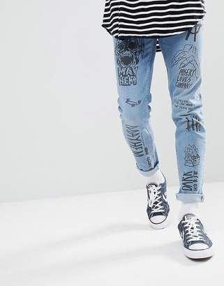 Asos Design Skinny Jeans In Mid Wash Blue With All Over Grunge Prints