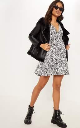 PrettyLittleThing White Leopard Wrap Front Skater Dress