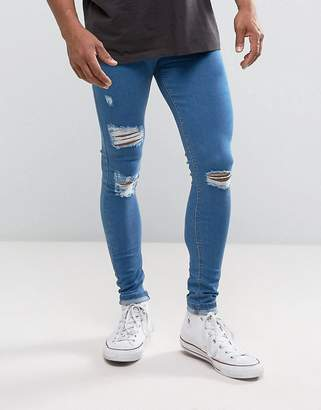 Criminal Damage Super Skinny Jeans In Blue With Distressing