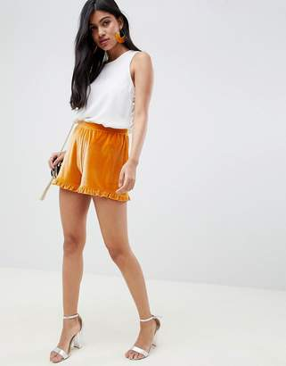 Asos Design DESIGN velvet shorts with ruffle hem