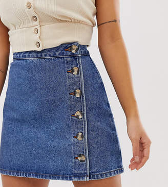 9354a0300e3 Asos DESIGN Petite denim wrap skirt with buttons in midwash blue