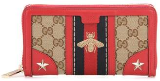 Gucci Leather and fabric zip-around wallet