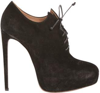 Alaia Lace Up Boots