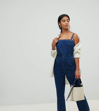 4450480d7d3a Asos DESIGN PETITE denim jumpsuit with strappy back in midwash blue