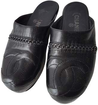 Chanel Leather mules & clogs
