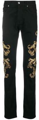 Versace embroidery and applique twill trousers